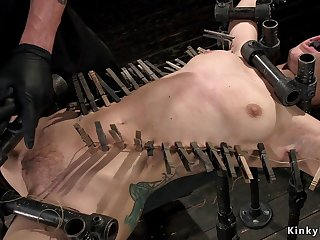 Darkhaired Babe gets zipper in device bondage