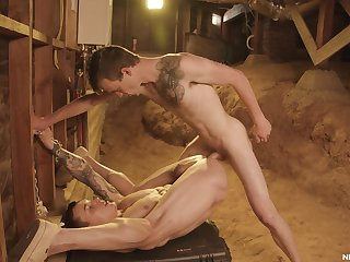 Gay twinks share the barn for a nice anal shag