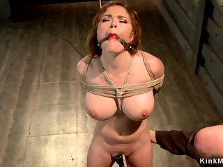 Huge boobs sub suspended in hogtie