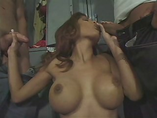 Busty wife Alexis Amore on her knees pleasuring two cocks at the same time