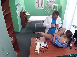 Unfaithful husband's clandestine fuck in a medical exam room