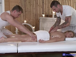 Excellent threesome on the massage table for the oiled blonde
