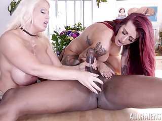 Tattooed Alura Jenson and Tana Lea share a big black blarney and its cum