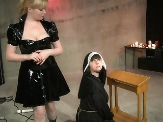Kinky lesbian nun gets her pussy abused by her mistress