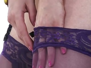 Red head in purple classy stockings having naughty fun