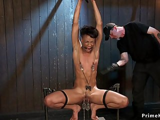 Ebony squirter gets coochie lips clamped