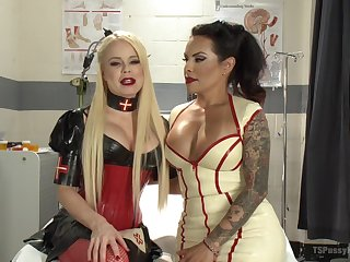 Costumed Nikki Delano gets her cunt banged by tranny TS Foxxy