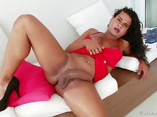Adorable tranny Camilla Lago makes herself cum using her hand
