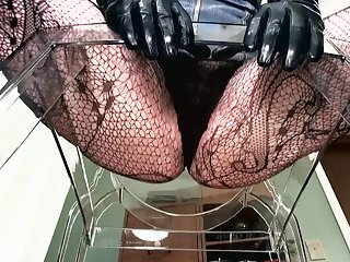 POINT-OF-VIEW of dominant female in fishnets
