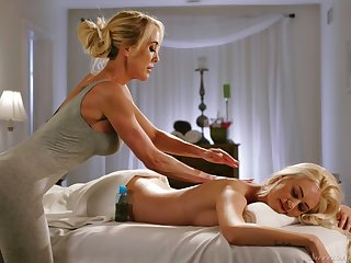 Mature lesbian masseuse Brandi Love gives a cunnilingus to young client